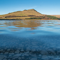 A mid afternoon view of Dovestone Reservoir from a low point of view on a clear winter afternoon.