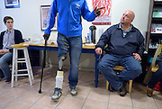 Windsor, Canada, 2012. Rob McGuffin, right, listens at Windsor Workers' Action Centre (WWAC) to  a Jamaican migrant worker telling his story about a work place accident. Interpares, a Guatemalan human rights organization, is on fact finding and awareness cross Canada tour and makes a stop at WWAC, a workers' rights organization.