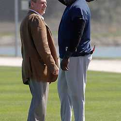 February 19, 2011; Fort Myers, FL, USA; Boston Red Sox first baseman David Ortiz and owner Larry Lucchino talk during spring training at the Player Development Complex.  Mandatory Credit: Derick E. Hingle