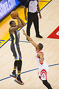 Golden State Warriors forward Kevin Durant (35) shoots a jumper over the Houston Rockets during Game 4 of the Western Conference Finals at Oracle Arena in Oakland, Calif., on May 22, 2018. (Stan Olszewski/Special to S.F. Examiner)