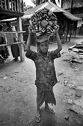 BANGLADESH UKHIA FEB95 - A young Chakma boy carries a load of firewood in Ukhia, southern Bangladesh...The Bangladesh Bureau of Statistics estimates the total working child population between 5 and 17 years old to be at 7.9 million...jre/Photo by Jiri Rezac..© Jiri Rezac 1995