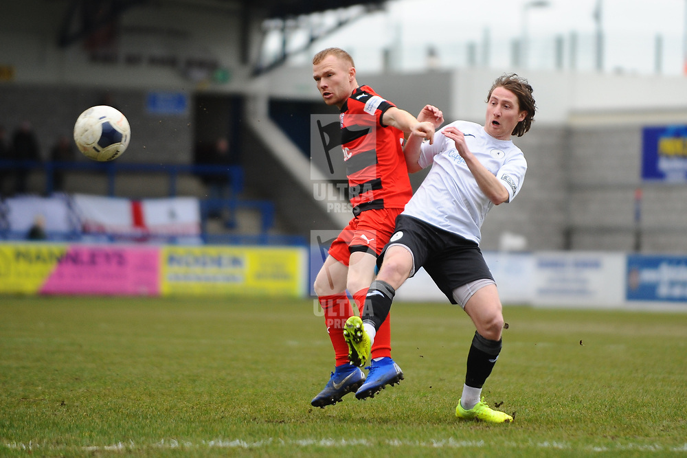 TELFORD COPYRIGHT MIKE SHERIDAN James McQuilkin of Telford battles for the ball with Adam Campbell  during the Vanarama Conference North fixture between AFC Telford United and Darlington at The New Bucks Head on Saturday, March 7, 2020.<br /> <br /> Picture credit: Mike Sheridan/Ultrapress<br /> <br /> MS201920-049