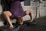 Isioma Nnodum works out at Crossfit Chili in Rochester on Tuesday, April 5, 2016.