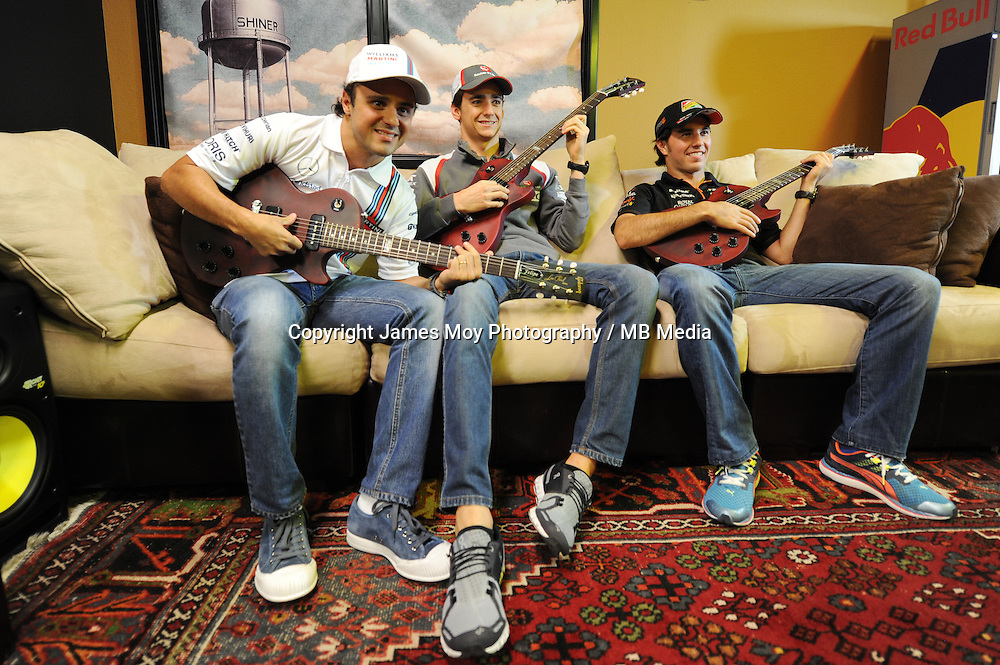 (L to R): Felipe Massa (BRA) Williams with Esteban Gutierrez (MEX) Sauber and Sergio Perez (MEX) Sahara Force India F1 at the Fans' Forum.<br /> United States Grand Prix, Wednesday 29th October 2014. Circuit of the Americas, Austin, Texas, USA.