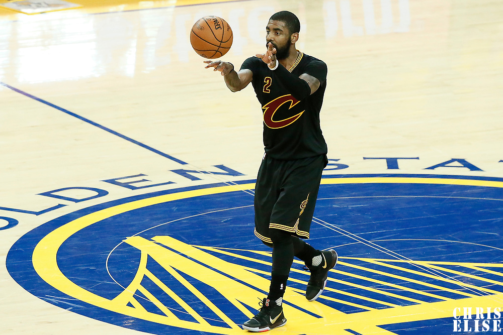 12 June 2017: Cleveland Cavaliers guard Kyrie Irving (2) passes the ball during the Golden State Warriors 129-120 victory over the Cleveland Cavaliers, in game 5 of the 2017 NBA Finals, at the Oracle Arena, Oakland, California, USA.