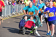 Neil (4628) runs the 10m with his kids during The Great South Run in Southsea, Portsmouth, United Kingdom on 23 October 2016. Photo by Jon Bromley.