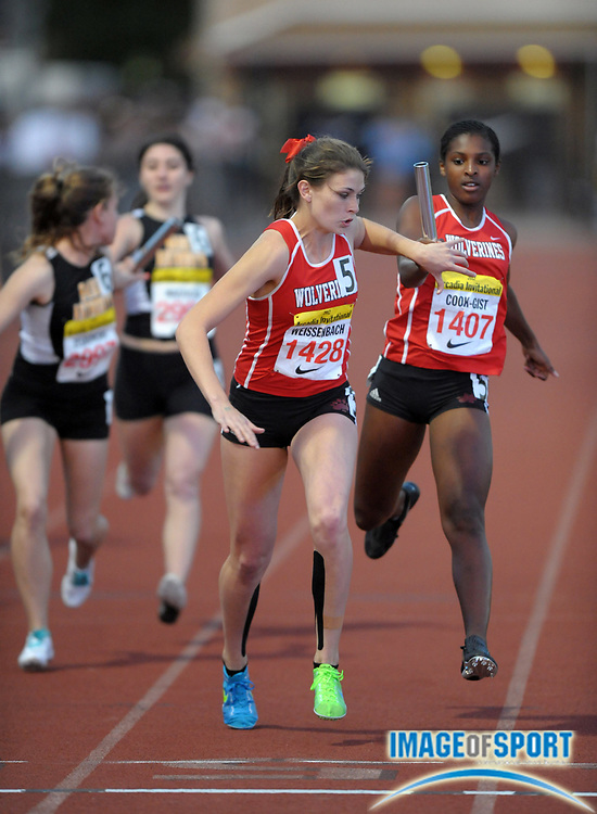 Apr 6, 2012; Arcadia, CA, USA; Amy Weissenbach takes the handoff from Imani Cook-Gist on the third 400m leg in the girls 1,600m sprint medley relay in the Arcadia Invitational at Arcadia High. Harvard-Westlake won in a meet-record 3:56.34.
