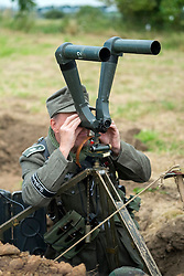 Reenactor from the Panzer Grenadier Division Großdeutschland looking through periscope binoculars<br />  17 July 2016<br />  Copyright Paul David Drabble<br />  www.pauldaviddrabble.photoshelter.com