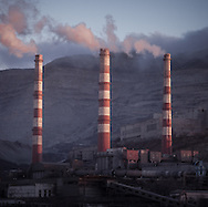 Industrial scene. Chimneys in the Russian Black Sea port of Novorossiysk