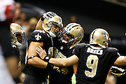NEW ORLEANS, LA - NOVEMBER 11:  Jimmy Graham #80 of the New Orleans Saints celebrates with teammates after scoring a touchdown against the Atlanta Falcons at Mercedes-Benz Superdome on November 11, 2012 in New Orleans, Louisiana.  The Saints defeated the Falcons 31-27.  (Photo by Wesley Hitt/Getty Images) *** Local Caption *** Jimmy Graham