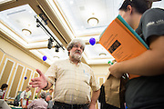 Steve Edinger, a lecturer with the Biological Sciences Department talks with students during the 2016 Ohio University Majors Fair held at the Baker Center Ballroom on Wednesday, September 14, 2016.
