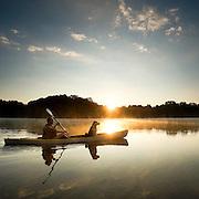 A man and his dog enjoy an early morning paddle on a lake near Charlotte, North Carolina.