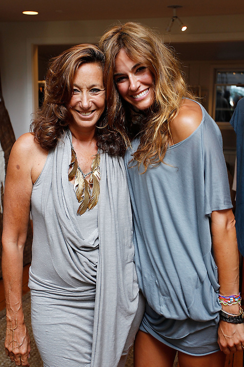 SAG HARBOR, NY - JULY 24: Designer Donna Karan (L) and  TV personality Kelly Bensimon attends the cocktail party for the launch of Aurelie Bidermann's Capsule Collection at Urban Zen on July 24, 2010 in Sag Harbor, New York.  (Photo by Joe Kohen/Getty Images for Aurelie)
