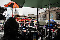 VATICAN CITY - 13 MARCH 2013: Al Jazeera correspondant Hoda Hamid reports on the conclave from Saint Peter's square, in Vatican City, on March 13, 2013...On March 12, 2013, the 115 cardinals entered the conclave to elect a successor to Pope Benedict XVI after he became the first pope in 600 years to resign from the role. The conclave will take place inside the Sistine Chapel and will be attended by 115 cardinals as they vote to select the 266th Pope of the Catholic Church.