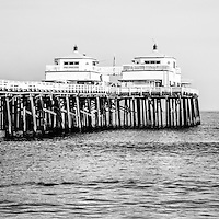 Malibu Pier black and white panorama picture in Malibu California. Malibu Pier is a historic landmark along the Pacific Ocean in Los Angeles County.