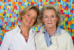 File photo - Sybille de Selys Longchamps and her daughter Delphine Boel pose in Belgium on October 4, 2012. The former king of Belgium, Albert II, has refused to undergo DNA testing in a case aimed at proving he fathered a love-child in the 1960s. A Brussels court ordered the ex-monarch, 84, to provide a saliva sample in three months or risk being presumed to be the father of Delphine Boel, 50. The ex-king denies the paternity claim and is said to be seeking legal advice on a possible appeal. Photo by AV Press/ABACAPRESS.COM