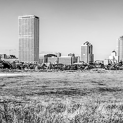 Panoramic of Milwaukee skyline black and white picture. High resolution panoramic photo ratio is 1:3 and includes Lakeshore State Park, US Bank building, University Club Tower, and Northwestern Mutual Tower. Lakeshore State Park is a Wisconsin State Park near downtown Milwaukee on Lake Michigan.