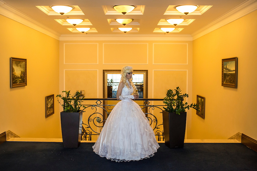 DONETSK, UKRAINE - MAY 18: A contestant at a bridal contest waits outside the room on May 18, 2014 in Donetsk, Ukraine. A week before presidential elections are scheduled, questions remain whether the eastern regions of Donetsk and Luhansk are stable enough to administer the vote. (Photo by Brendan Hoffman/Getty Images) *** Local Caption ***