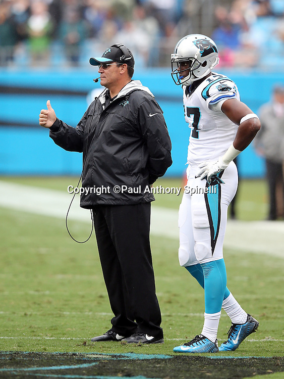 Carolina Panthers head coach Ron Rivera gives a thumbs up during the 2015 NFL week 3 regular season football game against the New Orleans Saints on Sunday, Sept. 27, 2015 in Charlotte, N.C. The Panthers won the game 27-22. (©Paul Anthony Spinelli)