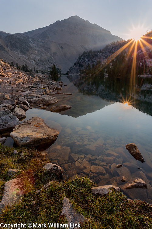 The sunburst on the evening horizon above Island Lake in the Big Boulder Creek drainage of the White Cloud Wilderness.
