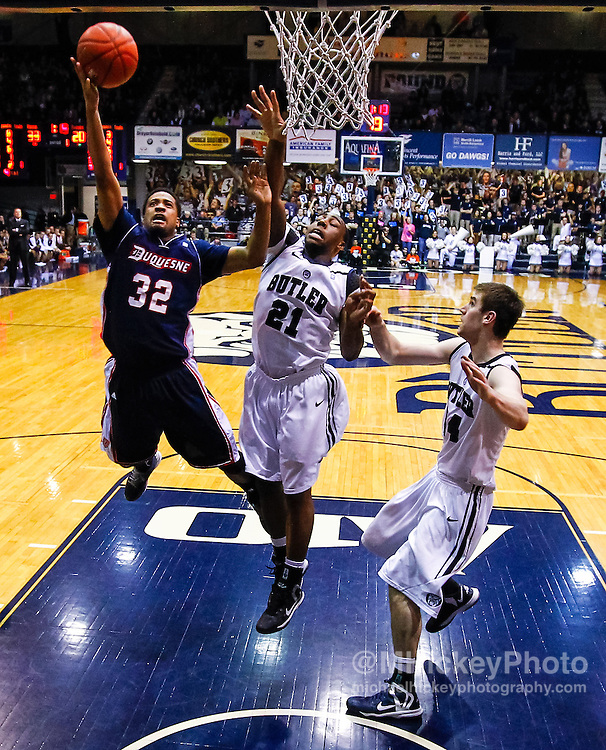 INDIANAPOLIS, IN - FEBRUARY 19: Sean Johnson #32 of the Duquesne Dukes shoots the ball against Roosevelt Jones #21 of the Butler Bulldogs at Hinkle Fieldhouse on February 19, 2013 in Indianapolis, Indiana. Butler defeated Duquesne 68-49. (Photo by Michael Hickey/Getty Images) *** Local Caption *** Sean Johnson; Roosevelt Jones