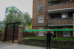 © Licensed to London News Pictures. 14/06/2019. London, UK. A family member of a victim puts a white flower on the names of people who lost their lives on a railings on a block of flats to commemorate the second anniversary of the Grenfell Tower fire service. On 14 June 2017, just before 1:00am a fire broke out in the kitchen of the fourth floor flat at the 24-storey residential tower block in North Kensington, West London, which took the lives of 72 people. More than 70 others were injured and 223 people escaped. Photo credit: Dinendra Haria/LNP