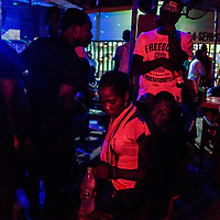 Civilians and militaries elements during a party in The New Travellers bar in Maiduguri