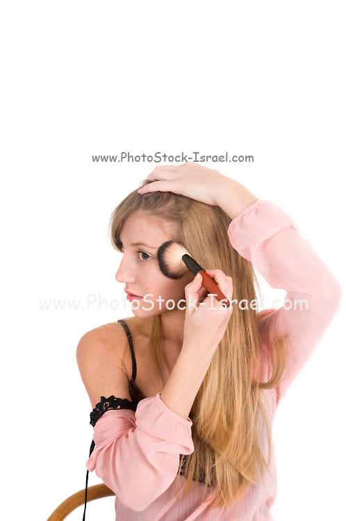 young woman in nightdress applies make-up On white Background