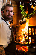 Chef Andrew Brochu, cooks over an open fire at Roister, a restaurant in the Fulton Market neighborhood of Chicago, Ill., on Thursday, May 12, 2016. Nathan Weber for New York Times