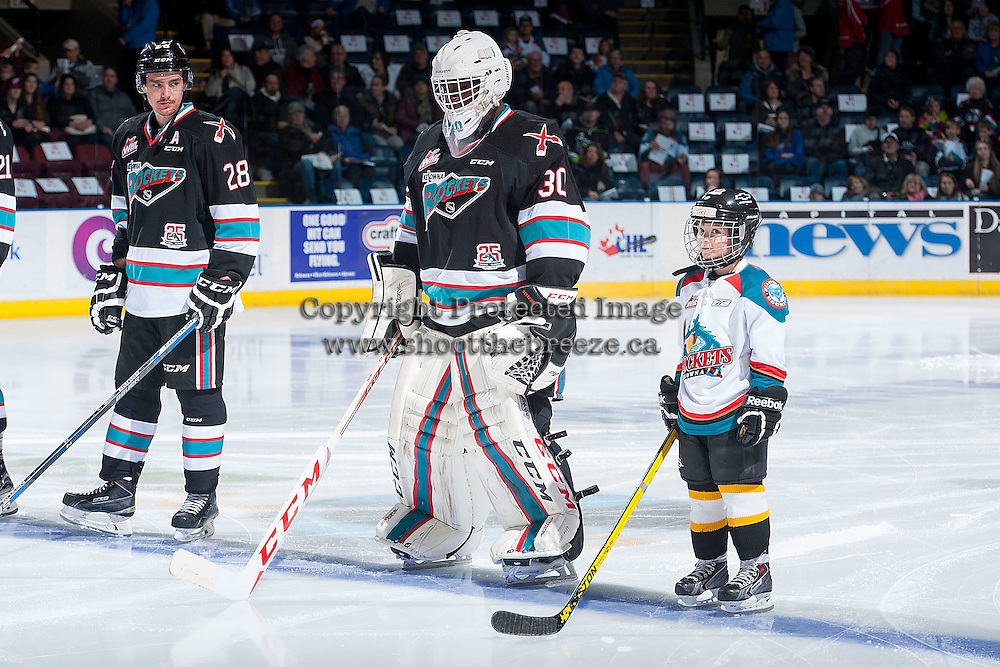 KELOWNA, CANADA - NOVEMBER 20: The Pepsi Save On Foods player of the game lines up beside Joe Gatenby #28 and Michael Herringer #30 of Kelowna Rockets against the Edmonton Oil Kings on November 20, 2015 at Prospera Place in Kelowna, British Columbia, Canada.  (Photo by Marissa Baecker/ShoottheBreeze)  *** Local Caption *** Michael Herringer; Pepsi player; Joe Gatenby;
