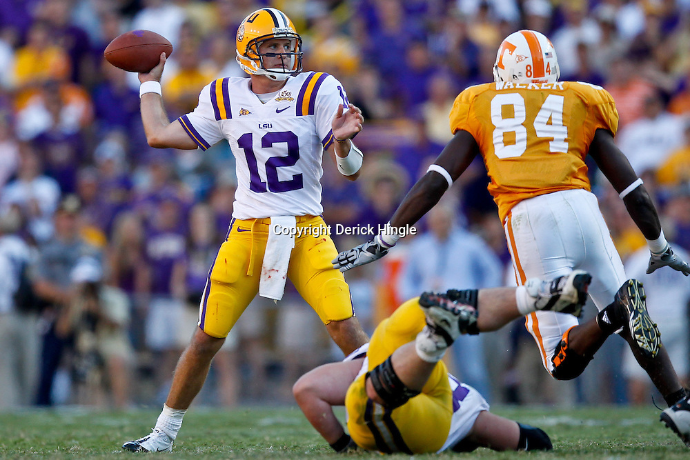 Oct 2, 2010; Baton Rouge, LA, USA; LSU Tigers quarterback Jarrett Lee (12) passes as Tennessee Volunteers defensive end Chris Walker (84) pressures on the play during the second half at Tiger Stadium. LSU defeated Tennessee 16-14.  Mandatory Credit: Derick E. Hingle