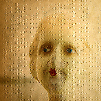 Conceptual image of a dolls face