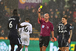 Davinson Sanchez of Tottenham Hotspur is shown the yellow card - Mandatory by-line: Craig Thomas/JMP - 02/01/2018 - FOOTBALL - Liberty Stadium - Swansea, England - Swansea City v Tottenham Hotspur - Premier League