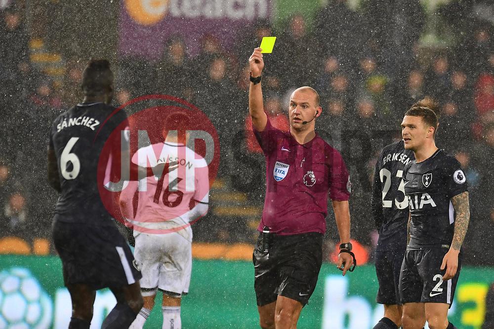 Davinson Sanchez of Tottenham Hotspur is shown the yellow card - Mandatory by-line: Craig Thomas/JMP - 02/01/2018 - FOOTBALL - Liberty Stadium - Swansea, England - Swansea City v Tottenham Hotspur - Premier League