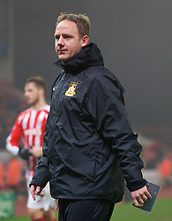 STOKE-ON-TRENT, ENGLAND - Sunday, January 4, 2015: Wrexham's coach Carl Darlington looks dejected after his side's 3-1 defeat by Stoke City during the FA Cup 3rd Round match at the Britannia Stadium. (Pic by David Rawcliffe/Propaganda)