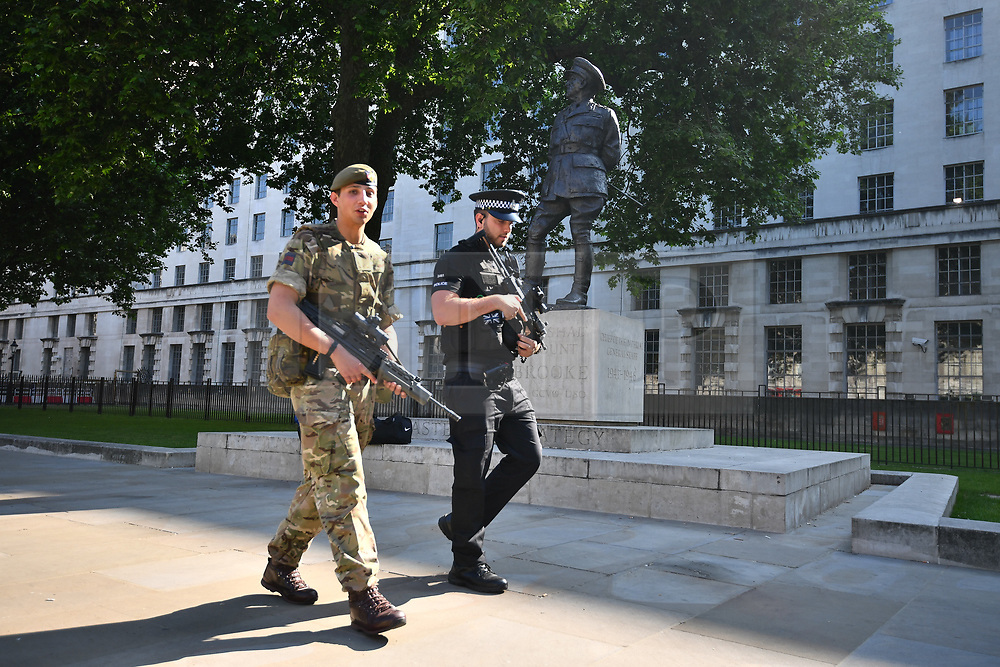 © Licensed to London News Pictures. 25/05/2017. London, UK. Armed soldiers and police payroll around In Westminster, London following a terrorist attack in Manchester, northern England, earlier this week. 23 people were killed an dozens more injured when Salman Abedi set off a suicide bomb at an Ariana Grande concert.  Photo credit: Ben Cawthra/LNP
