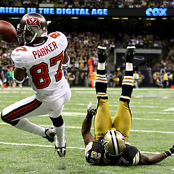 November 6, 2011; New Orleans, LA, USA; Tampa Bay Buccaneers wide receiver Preston Parker (87) is unable to hold on to a pass as New Orleans Saints safety Malcolm Jenkins (27) defends during the fourth quarter of a game at the Mercedes-Benz Superdome. The Saints defeated the Buccaneers 27-16. Mandatory Credit: Derick E. Hingle-US PRESSWIRE
