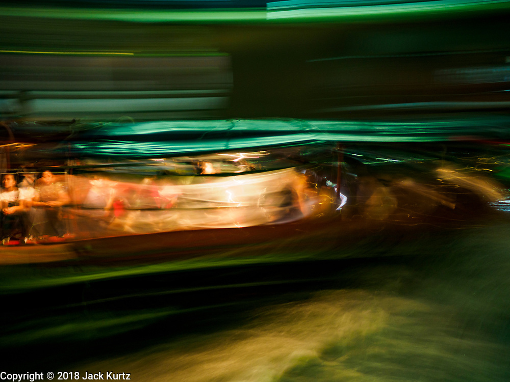 16 MAY 2018 - BANGKOK, THAILAND:  A passenger boat on Khlong Saen Saeb takes commuters home at the end of the work day.       PHOTO BY JACK KURTZ