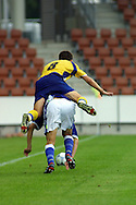 Juha Tamminen, 21.07.2001 Helsinki, Finland: UEFA Under-18 European Championship, Finland v Ukraine. Dmytro Pinchuk (UKR) jumps over Janne Hannula (FIN)..©JUHA TAMMINEN