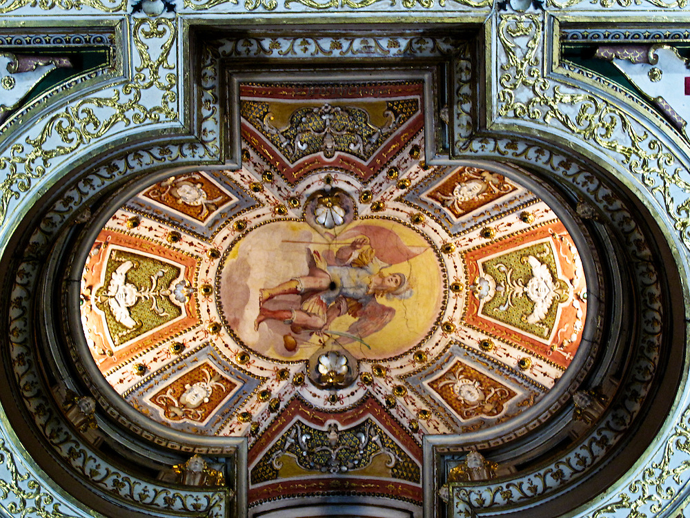 Yet another town house residence is the Casa Buonarotti, where the great Michelangelo's descendants maintained a home and a collection not only of his works but of other important artists.  The third floor consists of the residential area, a series of charming small rooms, decorated in 17th and 18th century style.   This charming dome drew my attention as a dome-collector, and the guard was willing to look the other way when I asked to make a picture, as long as I used no flash.  It has a delightful Rococo frivolity balanced with a severe geometric container.
