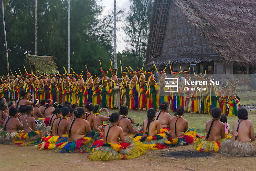 Yapese people watching Yap Day Festival performance in front of men's house, Yap Island, Federated States of Micronesia