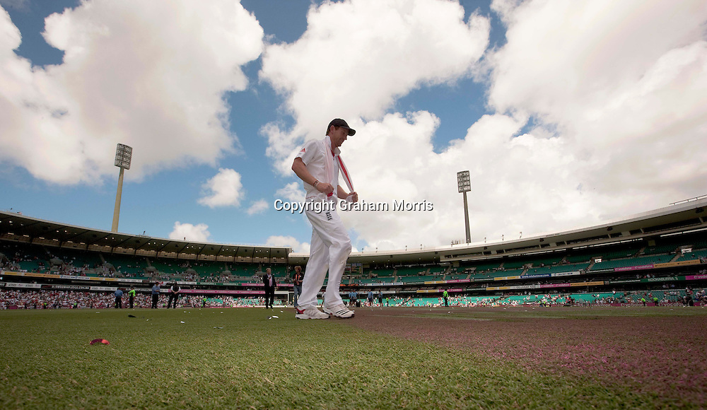 Retiring Paul Collingwood walks off alone with a smile on his face as England celebrate retaining the Ashes after beating Australia in the fifth and final Test match at the SCG in Sydney to win the series 3-1. Photo: Graham Morris (Tel: +44(0)20 8969 4192 Email: sales@cricketpix.com) 07/01/11