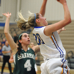 Staff photos by Tom Kelly IV<br /> East's Paige Warfel (20) goes up for a layup past Shanahan's Nicolette Juliana (4) during the Bishop Shanahan at Downingtown East girls basketball game, Thursday night December 18, 2013.