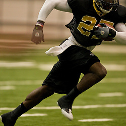 12 August 2009: New Orleans Saints cornerback Malcolm Jenkins (27) runs after intercepting a ball during New Orleans Saints training camp at the team's indoor practice facility in Metairie, Louisiana.