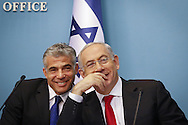 Israel's Prime Minister Benjamin Netanyahu (R), and Finance Minister Yair Lapid during a press conference in his office, speaking about the reform in Israel's seaports, in Jerusalem, on July 3, 2013. Photo by Oren Nahshon