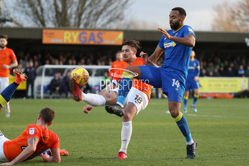 AFC Wimbledon midfielder Liam Trotter (14) battles for possession with Southend United defender Ryan Leonard (18) during the EFL Sky Bet League 1 match between AFC Wimbledon and Southend United at the Cherry Red Records Stadium, Kingston, England on 1 January 2018. Photo by Matthew Redman.