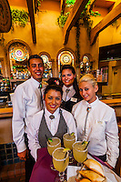 A bartender holding margaritas in the bar of the El Pinto Restaurant and Cantina, Albuquerque, New Mexico USA