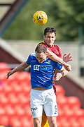 Carl McHugh (#4) of Motherwell FC wins a header over Chris Kane (#9) of St Johnstone FC during the Ladbrokes Scottish Premiership match between St Johnstone and Motherwell at McDiarmid Stadium, Perth, Scotland on 11 May 2019.