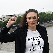 Malia Bouattia of Muslimahs Resist Trump upon his state visit to the UK, with a big banner hanging from Westminster Bridge, London (UK) on 12 July 2018.