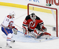 Jan 22, 2010; Newark, NJ, USA; New Jersey Devils goalie Martin Brodeur (30) makes a save on Montreal Canadiens left wing Mike Cammalleri (13) during the first period at the Prudential Center.